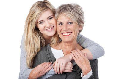 Older woman hugging her daughter near Shipp Family Dentistry in 39705