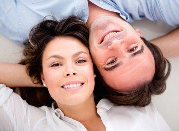 Young couple from above l Dental Implants l Shipp Family Dentistry