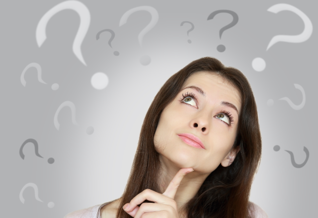 Woman thinking and looking up with questions marks around her head